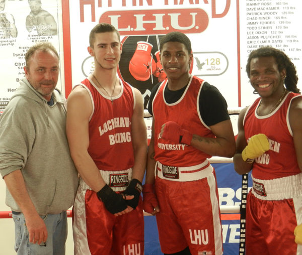 LHU boxing coach Ken Cooper stands with his participants in this weekend's East Regional tournament at the school's East Campus gym; from the left, Cooper, Colton Killian, James Earle and Tafari Gravasande.