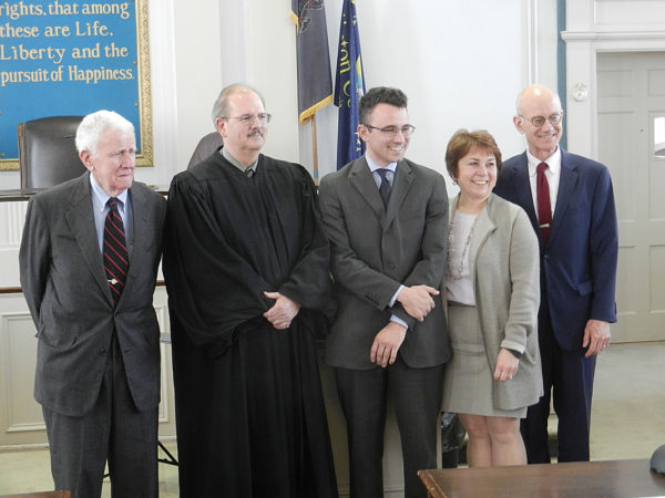 From the left: Allan Lugg, President Judge Craig Miller, new attorney John Lugg and John's parents Carol and Robert Lugg