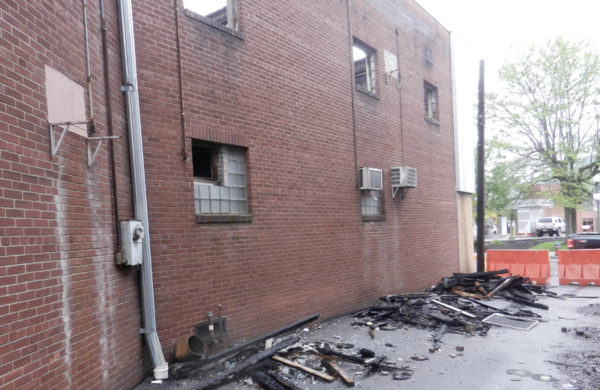 Willards Alley, adjacent to the 37-41 Bellefonte Ave. property that caught fire Dec. 16 last year, is still lined with debris and closed to the public.