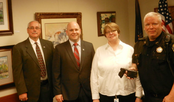 From the left, County Detective Charles Shoemaker, District Attorney Dave Strouse, Clinton County Women's Center Director Sandy Ludwig, County Sheriff Kerry Stover
