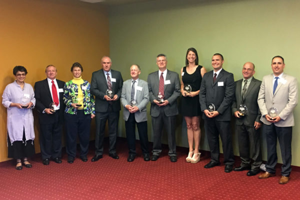 The 2017 LHU Athletics Hall of Fame Class, from the left: Dr. Gayatri Devi (accepted on behalf of Sharon Taylor), Ken Melchior, Sherry (Derr) Swope, Phil Stephenson, Fred Powell, Joby Topper (HOF Committee Chair; accepted in honor of Bob Peck), Courtney Hughes, Nick Slotterback, Carl Poff and Doug Spatafore (HOF Committee member; accepted on behalf of Fran Cornelius). Not pictured: Sara McMann (LHU head wrestling coach Scott Moore accepted on her behalf).